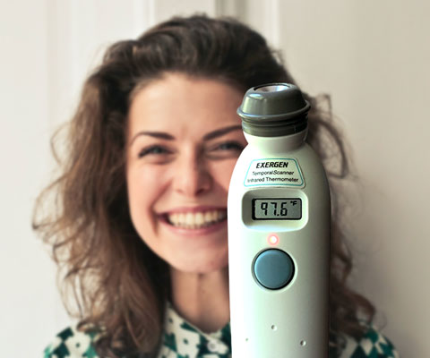 Smiling woman with thermometer